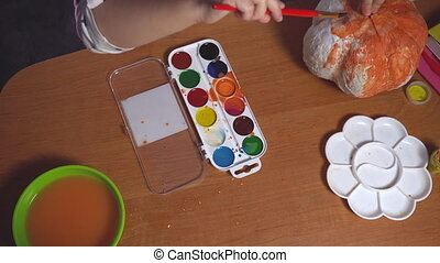 Top view on table where little girl colorizing some crafts ...
