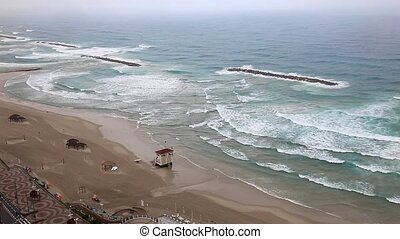 Top view on the beach of Tel Aviv in the rain