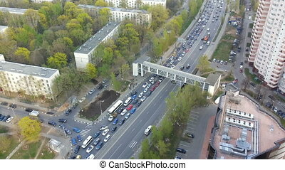 top view on the intersection of roads with heavy traffic of transport