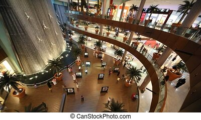Top view on visitors inside Dubai Mall in Dubai, UAE.
