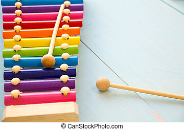 top view or flat lay on colorful toys on wooden background with copy space. Warm vintage filter
