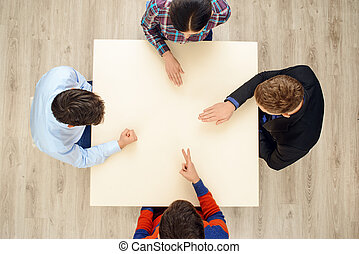 Top view people playing rock paper scissors