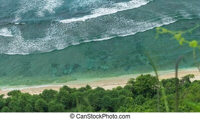Top view perspective of waves rolling one by one to the...