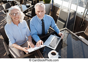Top view photo of smiling colleagues that looking upwards -...