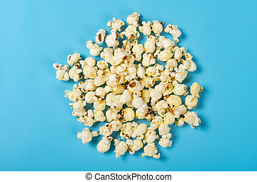 top view popcorn on a blue background