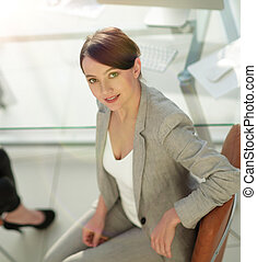 top view portrait of young business business woman sitting at th