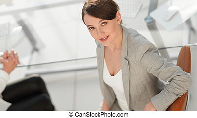 top view portrait of young business business woman sitting at the workplace.
