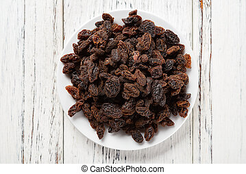 top view raisin on white wood background