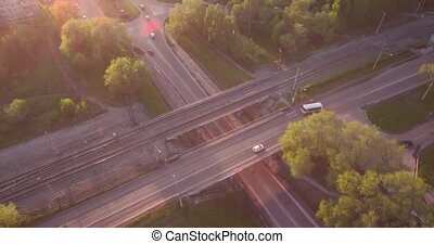 Top view round road junction in the smoll city in sunset. active city traffic cars. Aerial flight. 4K