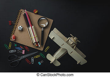 Top view sign of stationery education and back to school concept background. Mix different object on the modern rustic wood office desk.Essential several items for teen or adult to work and copy space