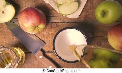 Top view slow motion pours apple juice in a mug