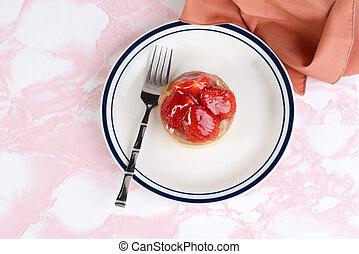 top view strawberry glazed tart with a napkin