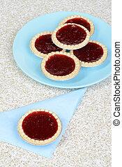 top view strawberry tart on blue napkin