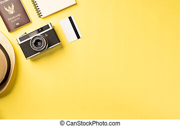 Top view summer concept with accessories on yellow background with copy space