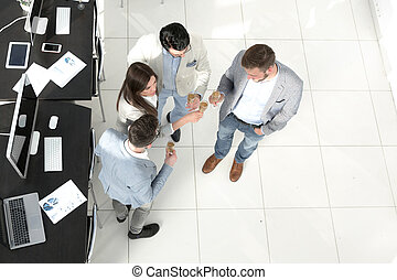 top view. the business team celebrates a successful startup