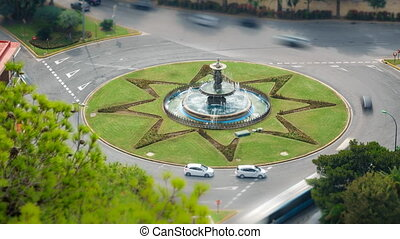 Top view time lapse of traffic circle, loop-ready