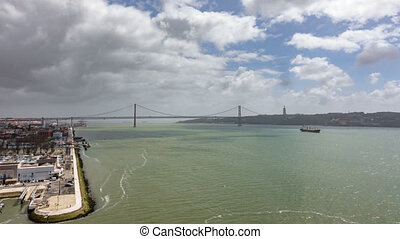 Top view timelapse of 25 de Abril Bridge from Belem district...