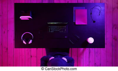 Gamer playing a game on a laptop. Streaming and watching others play.