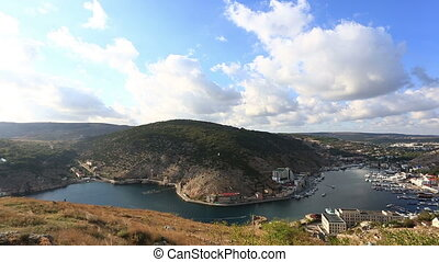 top view to Balaklava and Balaklava Bay in the sunny summer...