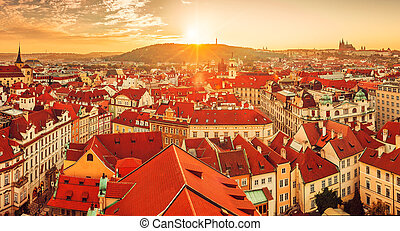 Top view to red roofs skyline of Prague city