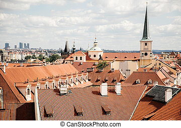 Top view to red tile roofs of Prague city