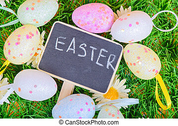 Top view to the easter eggs with chalkboard