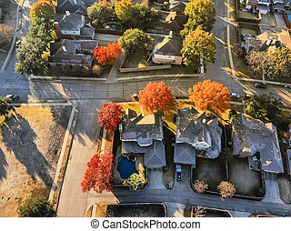 Top view typical park side houses with light snow covered roof in cold fall morning