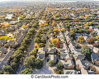Top view urban sprawl suburbs Dallas during autumn season with c