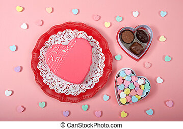 top view valentine's day heart cake and candy
