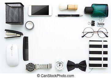 Top view white desk with men's accessories and office tools. Copy space in the middle for father's day greeting text. Black and white colors