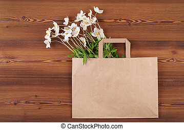 Top view wild anemones in the craft shopping bag