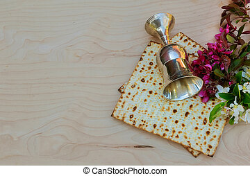 Top view wine and matzoh jewish passover bread over wooden...