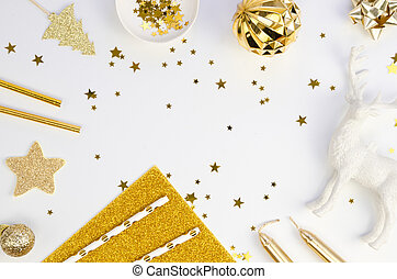 Top view Winter Christmas frame made of golden xmas tree decorations on a white table background. Holiday background with copy space for Happy New Year text