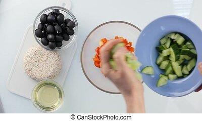 Top view. woman cooking vegetarian low calorie Greek salad,...
