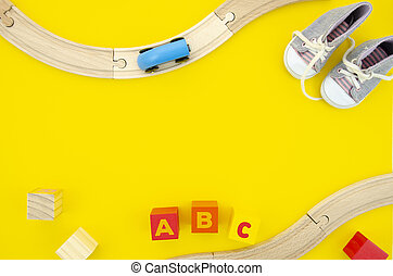 Top view wooden ABC cubes with letters, road and cars. Copy space for your text. Wooden toys frame mockup