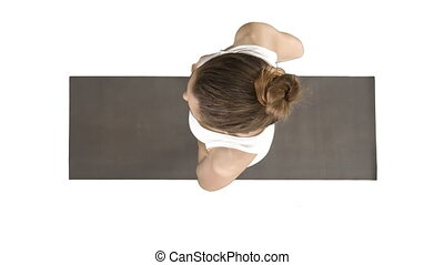 Young attractive woman practicing yoga doing tree exercise on white background.