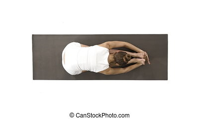 Young blond attractive woman practicing yoga, doing Seated...