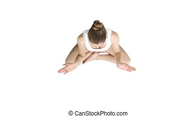 Young woman meditating in Lotus Pose on white background.