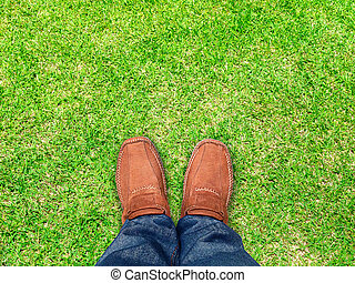 top view,Foot stand on grass ,Leave space for your content