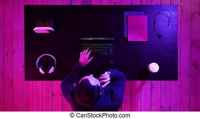 Gamer making a call. - Top view.Gamer making a call....