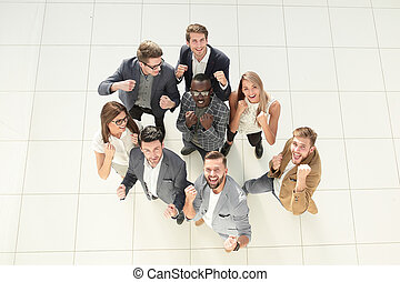 top view.happy business team . the concept of success