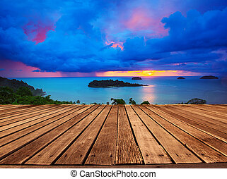 top wood panel terrace with beautiful dramatic sky of sun set an