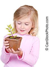 topfpflanze, haltend kind