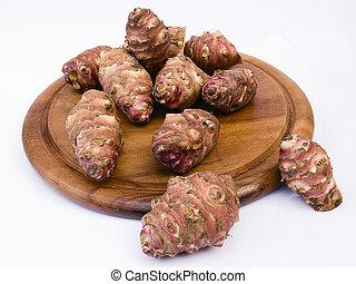 topinambur, raiz, ligado, um, redondo, board., também, sabido, como, jerusalém, alcachofra, (helianthus, tuberosus)., comestível, rizoma, nativo, para, américa do norte, com, um, gosto, semelhante, para, a, artichoke.