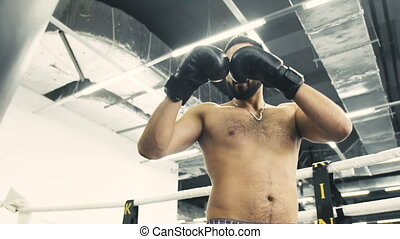 Topless Boxer Workout - Bearded topless boxer have punch...