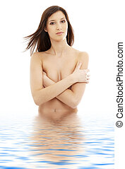 topless brunette with long hair in water