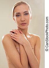 Topless female breast correction - Young topless female...