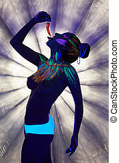Image of topless girl posing with chili under UV light