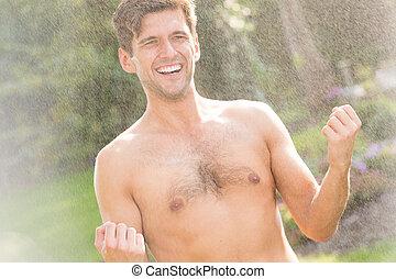 Topless man in the rain