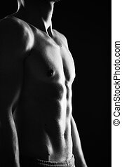 Topless man - Image of bare male torso in the darkness